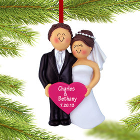 Bride and Groom Holding A Pink Heart Ornament