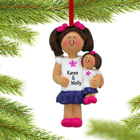 Little Girl Holding A Doll Ornament
